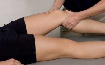 Sports massage on an athletes knee