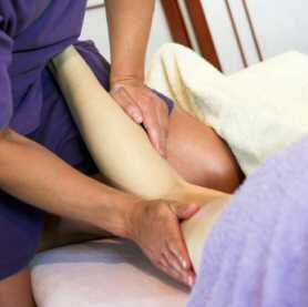 Sports massage to back of leg in the clinic