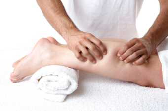 Sports massage to repair a damaged calf muscle